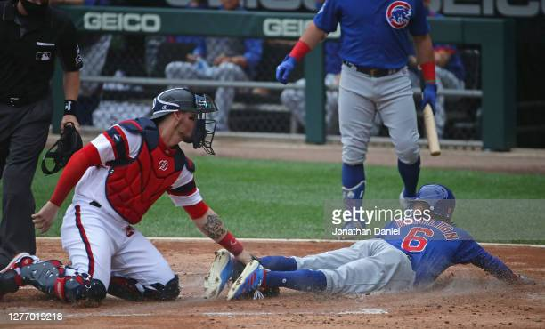 Billy Hamilton of the Chicago Cubs steals home plate to score a run as Yasmani Grandal of the Chicago White Sox applies the late tag in the 2nd...