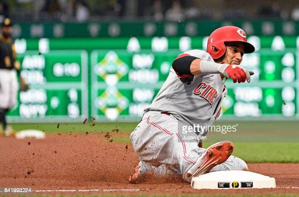 Billy Hamilton of the Cincinnati Reds advances to third base on a wild pitch by Jameson Taillon of the Pittsburgh Pirates in the first inning during...