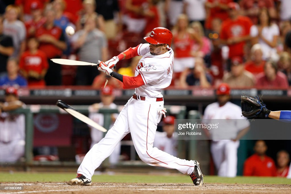 Billy Hamilton #6 of the Cincinnati Reds breaks his bat as he singles in the winning run in the ninth inning of the game against the Chicago Cubs at Great American Ball Park on July 8, 2014 in Cincinnati, Ohio. The Reds won 6-5.