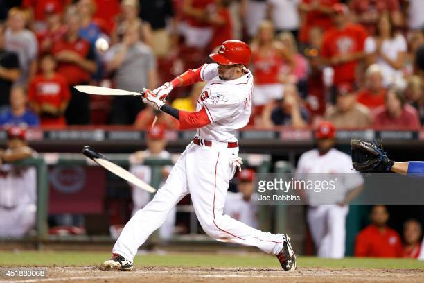 Billy Hamilton of the Cincinnati Reds breaks his bat as he singles in the winning run in the ninth inning of the game against the Chicago Cubs at...