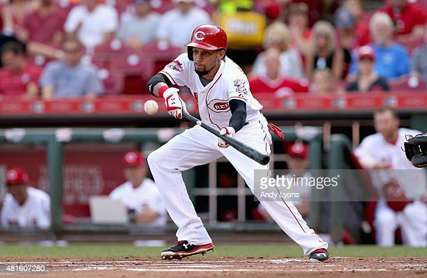 Billy Hamilton of the Cincinnati Reds bunts the ball for a single in the first inning against the Chicago Cubs during the second game of a...