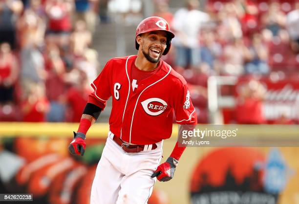 Billy Hamilton of the Cincinnati Reds celebrates after hitting the game winning home run in the 9th inning against the Milwaukee Brewers at Great...