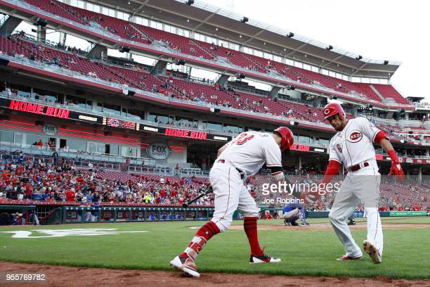 Billy Hamilton of the Cincinnati Reds celebrates with Jesse Winker after hitting a solo home run in the third inning against the New York Mets at...