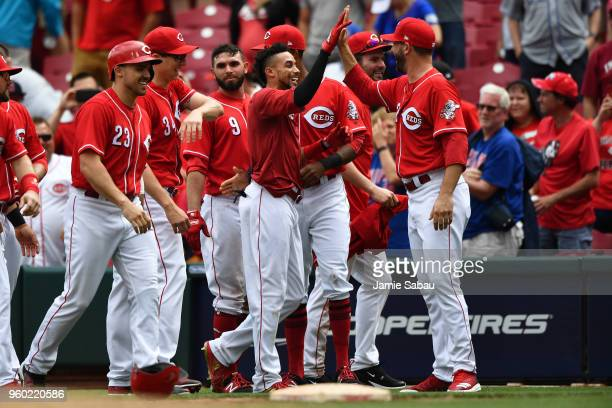 Billy Hamilton of the Cincinnati Reds celebrates with Matt Harvey of the Cincinnati Reds after walking in the winning run in the eleventh inning...