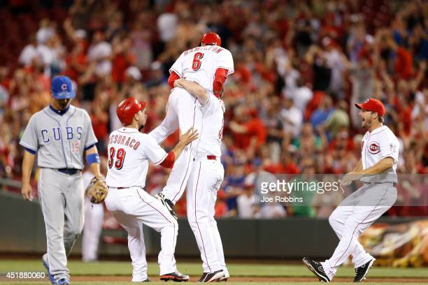 Billy Hamilton of the Cincinnati Reds celebrates with teammates after his walk off single that drove in the winning run in the ninth inning of the...
