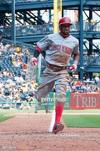 Billy Hamilton of the Cincinnati Reds comes in to score on a wild pitch by Curtis Partch of the Pittsburgh Pirates in the seventh inning during the...