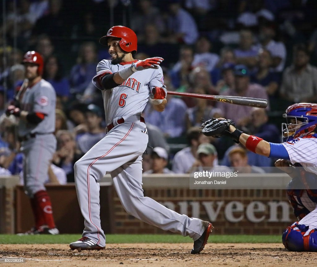 Billy Hamilton #6 of the Cincinnati Reds gets the game winning hit, a run scoring single in the 9th inning, against the Chicago Cubs at Wrigley Field on August 15, 2017 in Chicago, Illinois.
