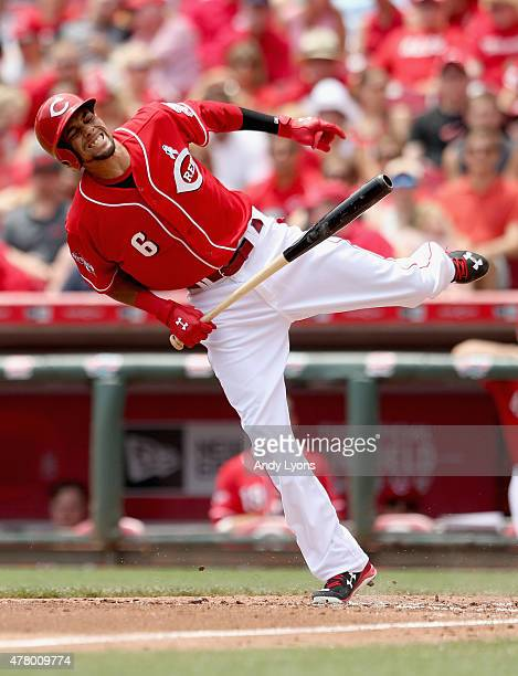 Billy Hamilton of the Cincinnati Reds grimaces after being hit a pitch in the the second inning during the game against the Miami Marlins at Great...