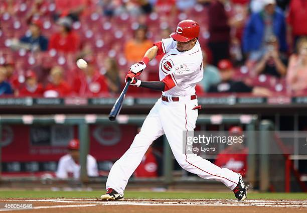 Billy Hamilton of the Cincinnati Reds hits a pitch during the game against the Milwaukee Brewers at Great American Ball Park on September 24 2014 in...