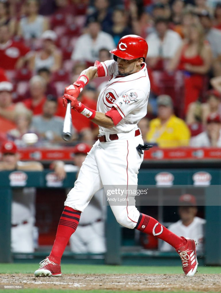 Billy Hamilton #6 of the Cincinnati Reds hits a single in the ninth inning against the Milwaukee Brewers at Great American Ball Park on June 28, 2018 in Cincinnati, Ohio.