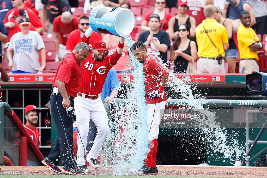Billy Hamilton #6 of the Cincinnati Reds is doused with Powerade by teammate Tyler Holt #40 after scoring the winning run on a wild pitch in the ninth inning against the Milwaukee Brewers at Great American Ball Park on July 17, 2016 in Cincinnati, Ohio. The Reds defeated the Brewers 1-0.