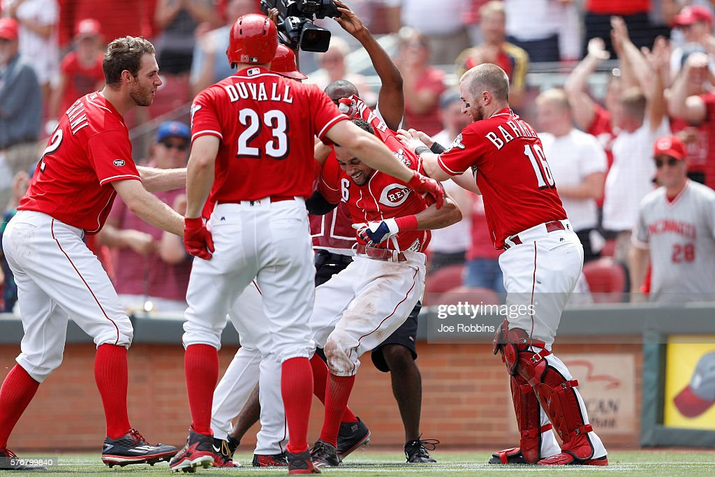 Billy Hamilton #6 of the Cincinnati Reds is mobbed by teammates after scoring the winning run on a wild pitch in the ninth inning against the Milwaukee Brewers at Great American Ball Park on July 17, 2016 in Cincinnati, Ohio. The Reds defeated the Brewers 1-0.