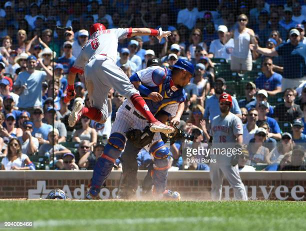 Billy Hamilton of the Cincinnati Reds is safe at home as Willson Contreras of the Chicago Cubs can't handle the throw during the fifth inning on July...