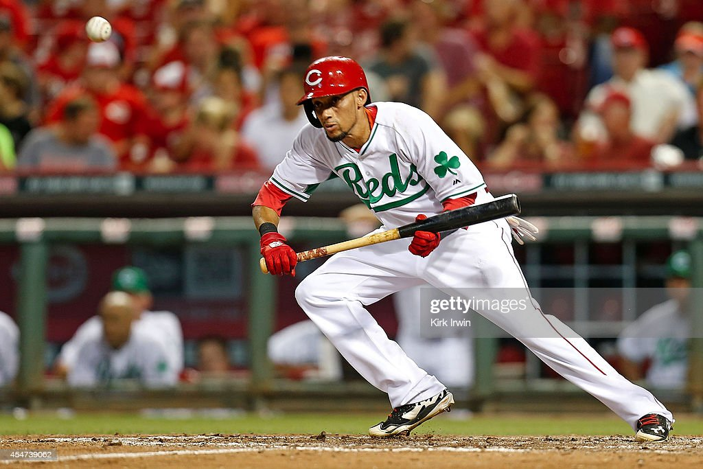 Billy Hamilton #6 of the Cincinnati Reds lays down a bunt during the fifth inning against the New York Mets at Great American Ball Park on September 5, 2014 in Cincinnati, Ohio. New York defeated Cincinnati 14-5.