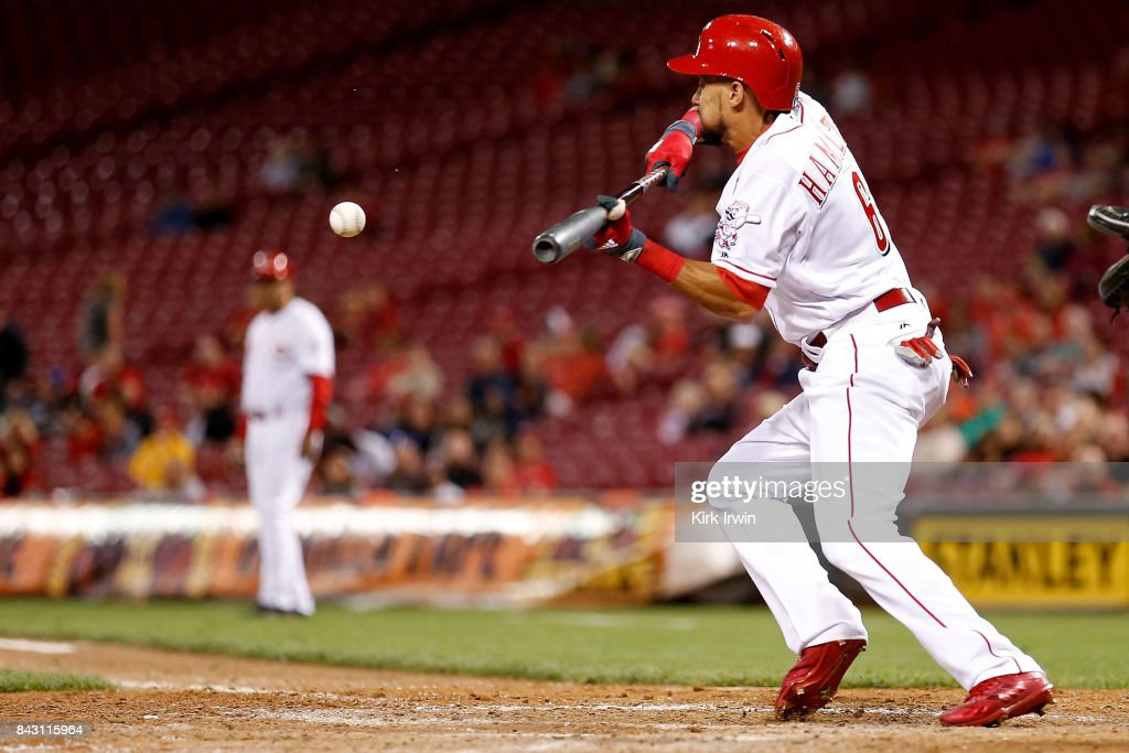 Billy Hamilton #6 of the Cincinnati Reds lays down a sacrifice bunt during the eighth inning of the game against the Milwaukee Brewers at Great American Ball Park on September 5, 2017 in Cincinnati, Ohio. Cincinnati defeated Milwuakee 9-3.