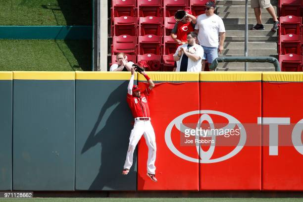 Billy Hamilton of the Cincinnati Reds makes a catch against the center field wall to take a hit away from Matt Carpenter of the St Louis Cardinals in...