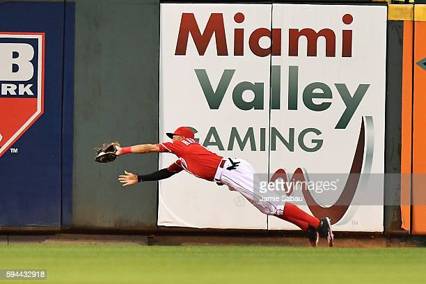 Billy Hamilton of the Cincinnati Reds makes a diving catch in center field of a fly ball off the leadoff hitter of the Texas Rangers in the sixth...