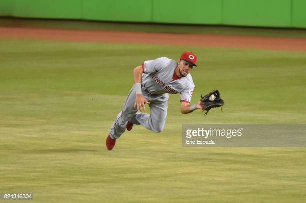 Billy Hamilton of the Cincinnati Reds makes a diving catch in the fourth inning against the Miami Marlins at Marlins Park on July 29 2017 in Miami...
