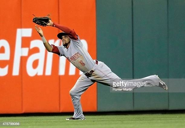 Billy Hamilton of the Cincinnati Reds makes a diving catch on a fly ball in the ninth inning during a game against the Philadelphia Phillies at...