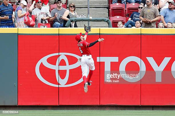 Billy Hamilton of the Cincinnati Reds makes a jumping catch to force out Ben Revere of the Washington Nationals during the first inning at Great...