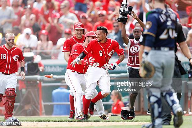 Billy Hamilton of the Cincinnati Reds reacts after scoring the winning run on a wild pitch in the ninth inning against the Milwaukee Brewers at Great...