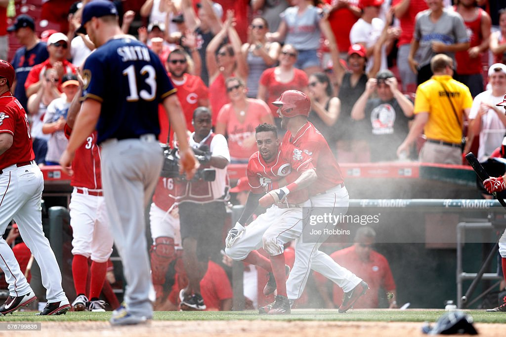 Billy Hamilton #6 of the Cincinnati Reds reacts after scoring the winning run on a wild pitch in the ninth inning by Will Smith #13 of the Milwaukee Brewers at Great American Ball Park on July 17, 2016 in Cincinnati, Ohio. The Reds defeated the Brewers 1-0.