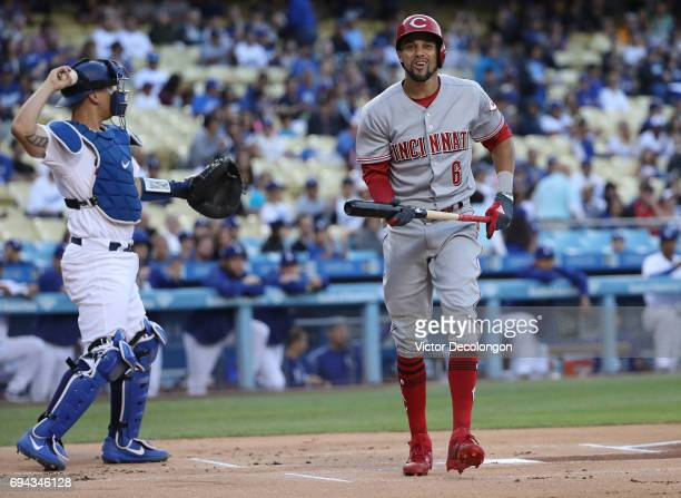 Billy Hamilton of the Cincinnati Reds reacts after striking out in the first inning as catcher Austin Barnes of the Los Angeles Dodgers throws the...
