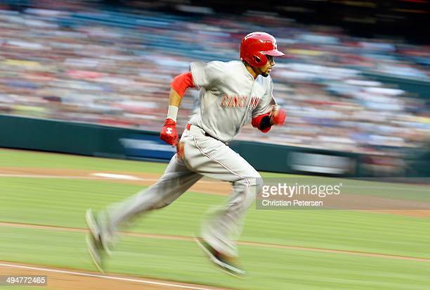 Billy Hamilton of the Cincinnati Reds runs to first base after hitting a single against the Arizona Diamondbacks during the second inning of the MLB...