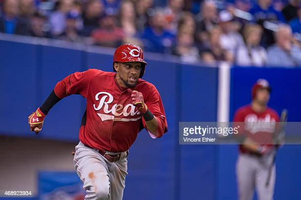 Billy Hamilton of the Cincinnati Reds runs to first base during the exhibition game against the Toronto Blue Jays at Olympic Stadium on Friday April...
