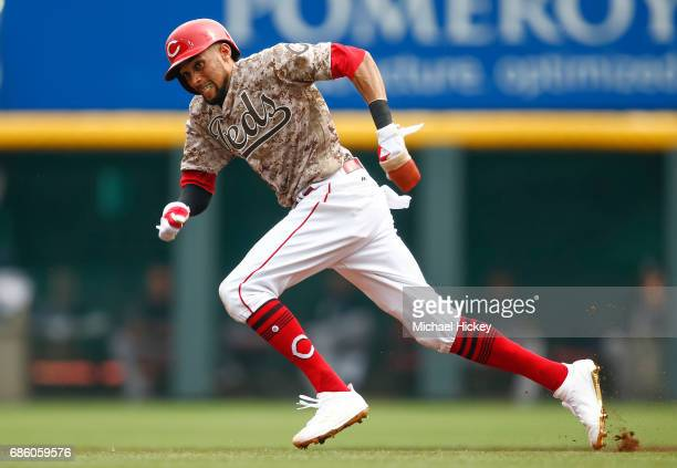 Billy Hamilton of the Cincinnati Reds runs to steal second base during the first inning against the Colorado Rockies at Great American Ball Park on...