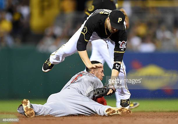 Billy Hamilton of the Cincinnati Reds safely steals second base in front of Neil Walker of the Pittsburgh Pirates during the sixth inning on August...