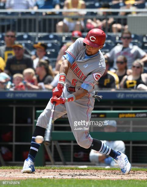 Scott Schebler of the Cincinnati Reds celebrates with Billy Hamilton after hitting a two run home run in the ninth inning during the game against the...