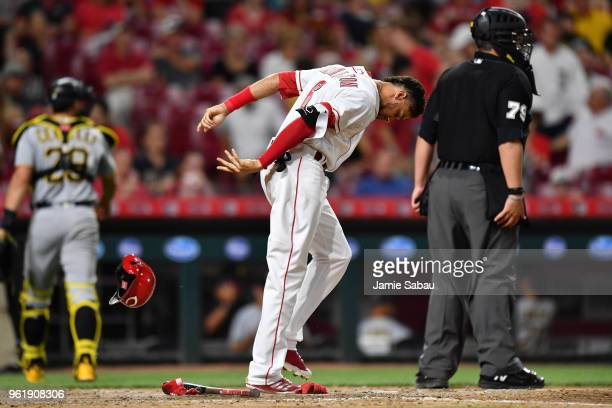 Billy Hamilton of the Cincinnati Reds slams his helmet to the ground after striking out to end the seventh inning against the Pittsburgh Pirates at...