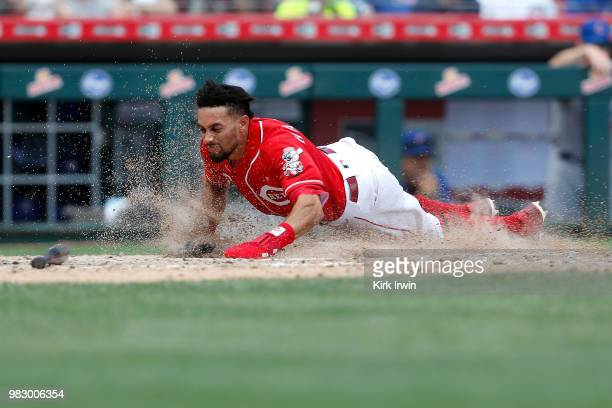 Billy Hamilton of the Cincinnati Reds slides into home to score a run during the seventh inning of the game against the Chicago Cubs at Great...