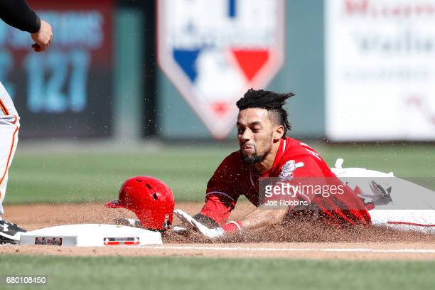 Billy Hamilton of the Cincinnati Reds slides safely into third base with a triple against the San Francisco Giants in the second inning of a game at...