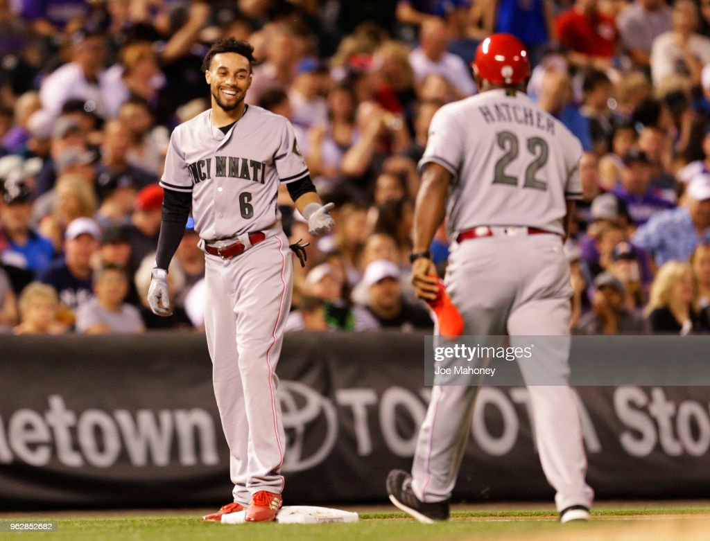 Billy Hamilton #6 of the Cincinnati Reds smiles at Billy Hatcher #22 of the Cincinnati Reds after Hamilton's triple in the seventh inning against the Colorado Rockies at Coors Field on May 26, 2018 in Denver, Colorado.