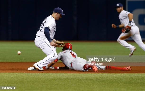 Billy Hamilton of the Cincinnati Reds steals second base ahead of shortstop Daniel Robertson of the Tampa Bay Rays during the fourth inning of a game...