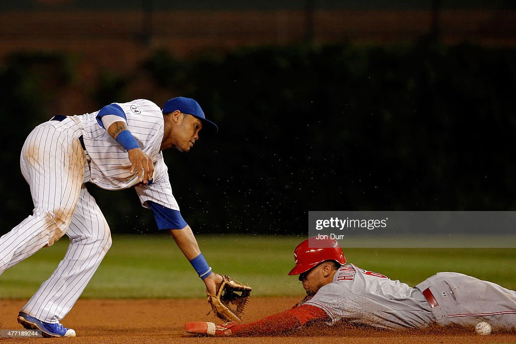 Billy Hamilton #6 of the Cincinnati Reds steals second base as Addison Russell #22 of the Chicago Cubs takes the throw during the tenth inning at Wrigley Field on June 14, 2015 in Chicago, Illinois.