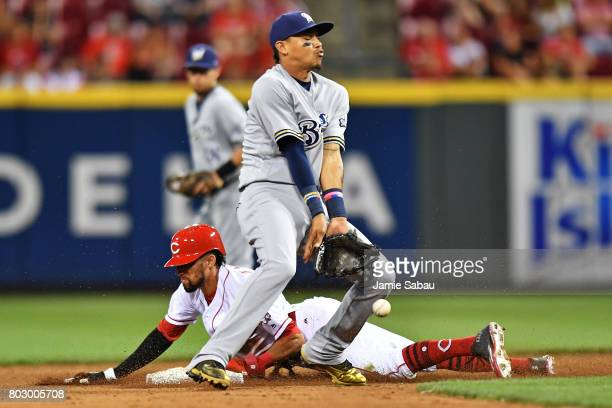 Billy Hamilton of the Cincinnati Reds steals second base in the eighth inning as Orlando Arcia of the Milwaukee Brewers bobbles the throw at Great...