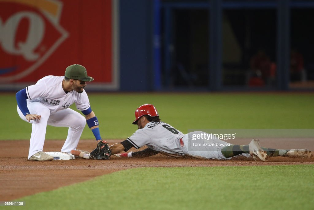 Billy Hamilton #6 of the Cincinnati Reds steals second base in the first inning during MLB game action as Devon Travis #29 of the Toronto Blue Jays applies the tag at Rogers Centre on May 29, 2017 in Toronto, Canada.