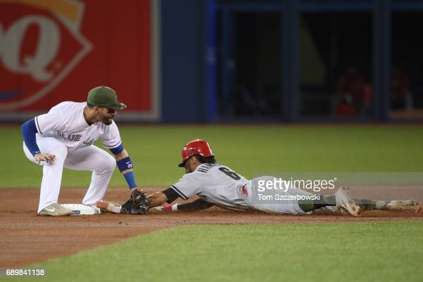 Billy Hamilton of the Cincinnati Reds steals second base in the first inning during MLB game action as Devon Travis of the Toronto Blue Jays applies...