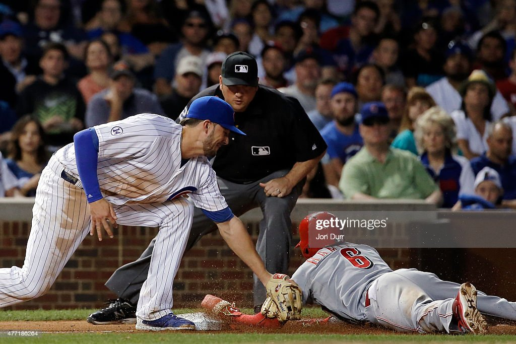 Billy Hamilton #6 of the Cincinnati Reds steals third base as Kris Bryant #17 of the Chicago Cubs applies the tag during the sixth inning at Wrigley Field on June 14, 2015 in Chicago, Illinois.