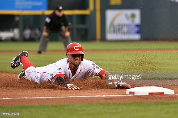 Billy Hamilton of the Cincinnati Reds steals third base in the second inning against the Colorado Rockies at Great American Ball Park on April 19...