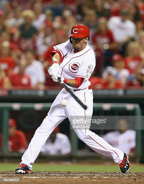 Billy Hamilton of the Cincinnati Reds swings at a pitch during the game against the Chicago Cubs at Great American Ball Park on September 10 2013 in...