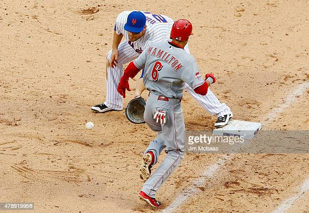 Billy Hamilton of the Cincinnati Reds tries to run out a third inning bunt attempt as Lucas Duda of the New York Mets gets the force at first base at...