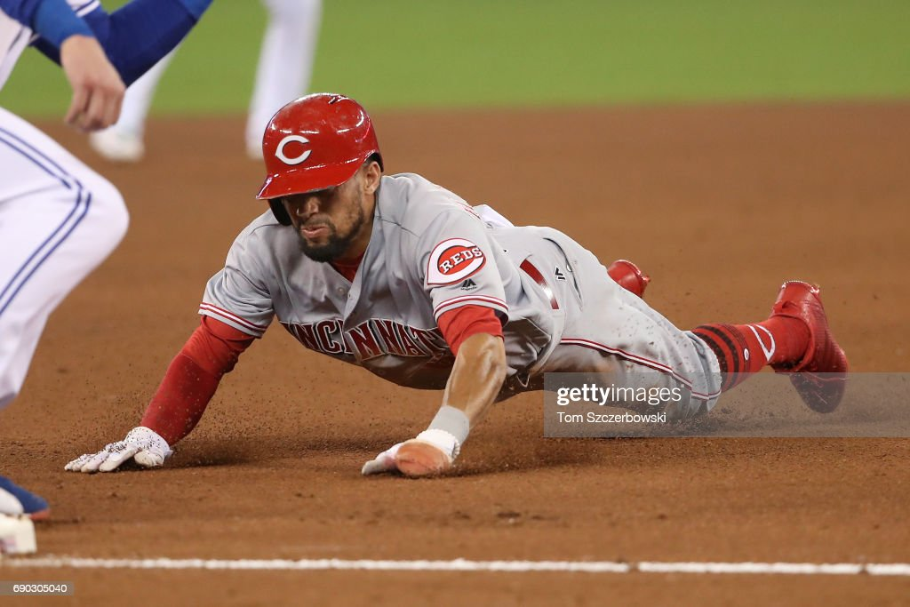 Billy Hamilton #6 of the Cincinnati Reds was caught stealing third base on this play in the seventh inning during MLB game action against the Toronto Blue Jays at Rogers Centre on May 30, 2017 in Toronto, Canada.