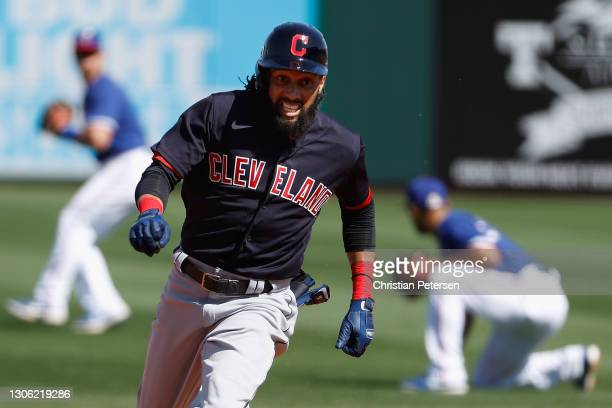 Billy Hamilton of the Cleveland Indians runs out a triple during the fourth inning of the MLB spring training game against the Texas Rangers on March...