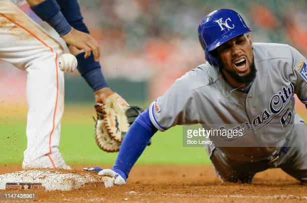 Billy Hamilton of the Kansas City Royals reacts after being hit in the elbow by Gerrit Cole of the Houston Astros on pick off play in the fifth...