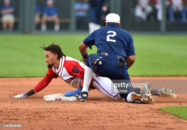 Billy Hamilton of the Kansas City Royals slides into second for a steal past second baseman Luis Arraez of the Minnesota Twins in the fourth inning...