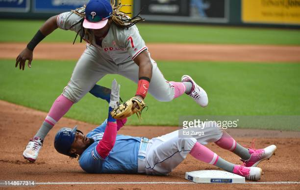 Billy Hamilton of the Kansas City Royals slides into third and collides into third baseman Maikel Franco of the Philadelphia Phillies as he advances...